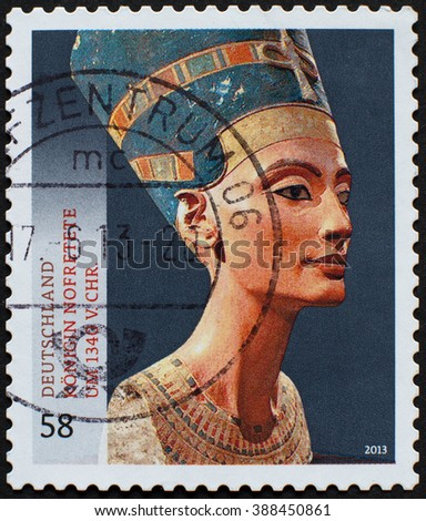 Germany - circa 2013: postal stamp show the bust of Nefertiti from the Agyptisches Museum Berlin collection, presently in the Neues Museum. Printed in Germany, 2013 - stock photo