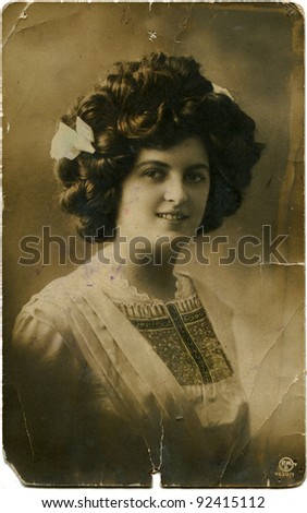GERMANY - CIRCA 1934: Reproduction of antique postcard shows beautiful woman, circa 1934