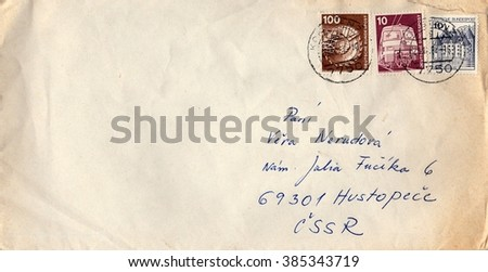 GERMANY - CIRCA 1980s: A vintage used envelope and stamps. Rich stain and paper details. Can be used as background.