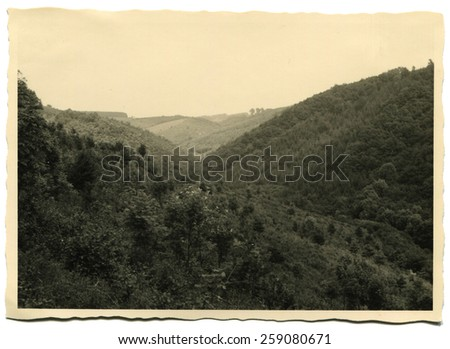 GERMANY - CIRCA 1960s: Forested mountains - stock photo