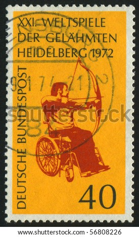 GERMANY- CIRCA 1972: stamp printed by Germany, shows Archer in Wheelchair, circa 1972. - stock photo