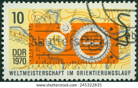 GERMANY- CIRCA 1970: stamp printed by Germany, shows Competition Map and compass, circa 1970. - stock photo