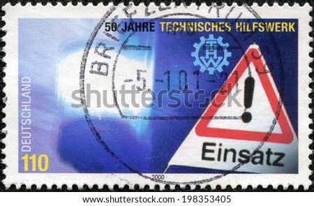 GERMANY - CIRCA 2000: stamp printed by Germany, shows danger sign, circa 2000. - stock photo