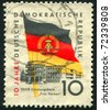 GERMANY - CIRCA 1959: stamp printed by Germany, shows Flag and building, circa 1959 - stock photo