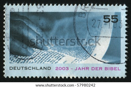 GERMANY- CIRCA 2003: stamp printed by Germany, shows hand on the Bible, circa 2003.