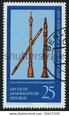 GERMANY - CIRCA 1977: stamp printed by Germany, shows oboe, clarinet, flute, France, circa 1977.