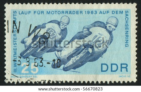 GERMANY - CIRCA 1963: stamp printed by Germany, shows two motorcyclists at Sachsenring, circa 1963. - stock photo