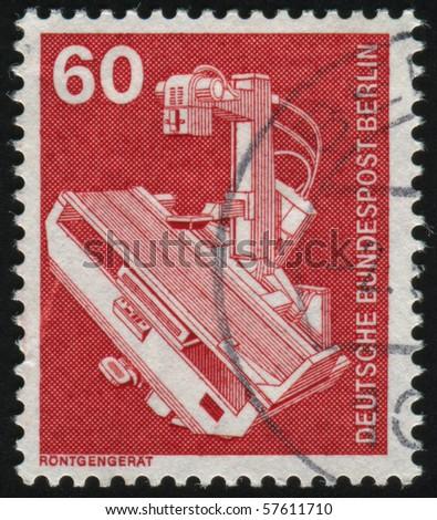 GERMANY- CIRCA 1978: stamp printed in Germany, shows X-ray machine, circa 1978. - stock photo