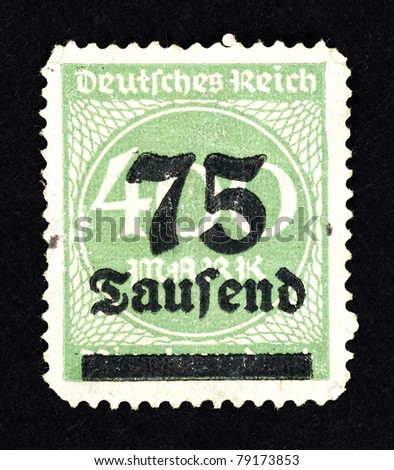 GERMANY - CIRCA 1921: Stamps printed in Germany with intricate green web pattern and a face value of 75 thousand Marks,  for the hyperinflation period of the Deutsches Reich, circa 1921.