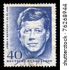 GERMANY - CIRCA 1964. Vintage postage stamp printed in Germany shows a memorialized John F. Kennedy, circa 1964. - stock photo