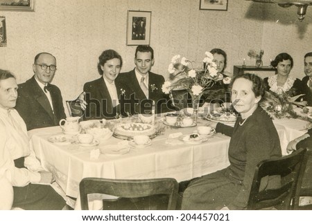 GERMANY, DECEMBER 31, 1952 - vintage photo of newlyweds and their family