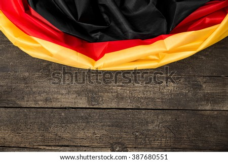 Germany Flag on wooden background with copyspace