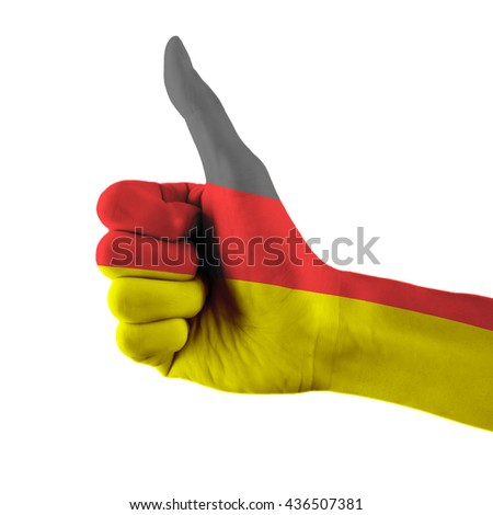 Germany flag painted hand showing thumbs up sign on isolated white background with clipping path - stock photo