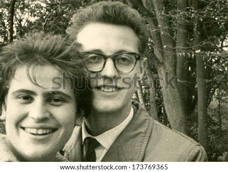 GERMANY, GORLITZ - 1960s: An antique photo shows young couple on the street - stock photo