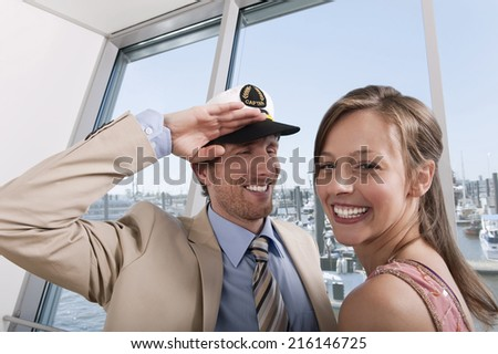 Germany, Hamburg, man saluting woman - stock photo