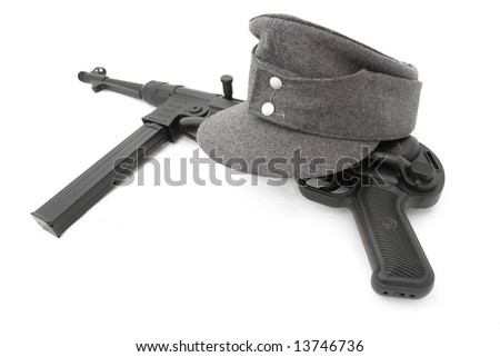 Germany in the Second World War. Composition with standard army field cap (kepi) and submachine gun MP40 - stock photo