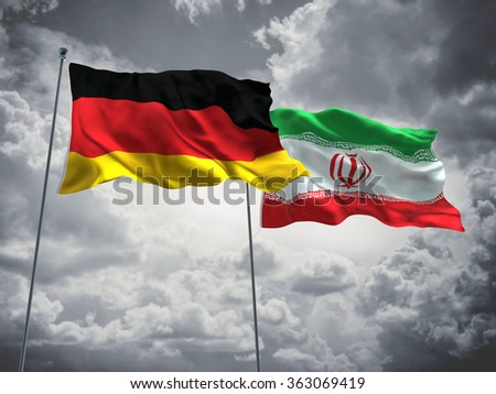 Germany & Iran Flags are waving in the sky with dark clouds  - stock photo