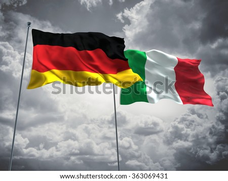 Germany & Italy Flags are waving in the sky with dark clouds  - stock photo
