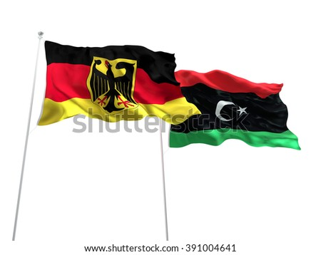 Germany & Libya Flags are waving on the isolated white background - stock photo