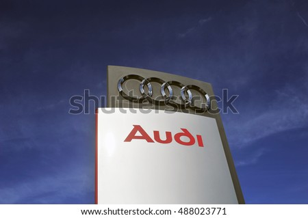 GERMANY-SEPT 22:AUDI logo in the blue sky on September 22,2016 in Germany.Audi is a German automobile manufacturer that designs, engineers, produces, markets and distributes luxury vehicles in Bavaria