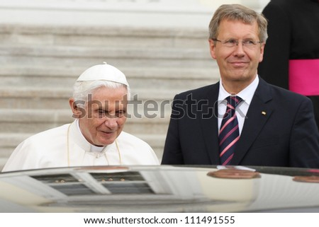 GERMANY - SEPTEMBER 22: Reception of Pope Benedict XVI, from Federal President Christian Wulff and his wife Bettina Wulff at Schloss Bellevue on September 22, 2012 in Berlin, Germany. - stock photo