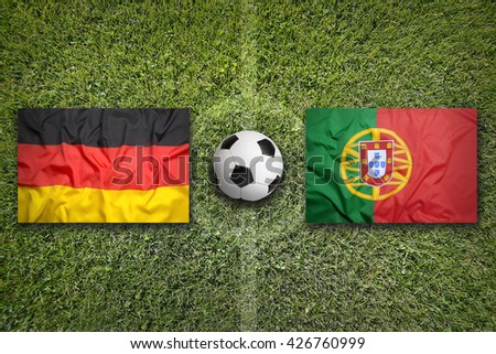 Germany vs. Portugal flags on a green soccer field