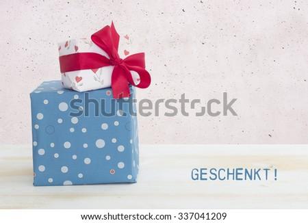 geschenkt - voucher in german - stock photo