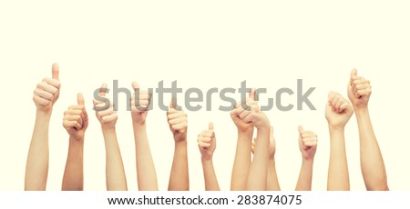 gesture and body parts concept - hands showing thumbs up - stock photo