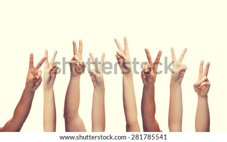 gesture and body parts concept - human hands showing v-sign - stock photo