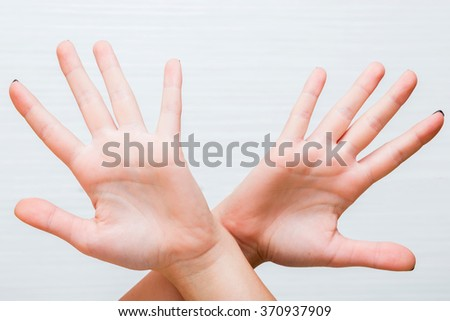 gesture and body parts concept - two woman hands waving hands - stock photo