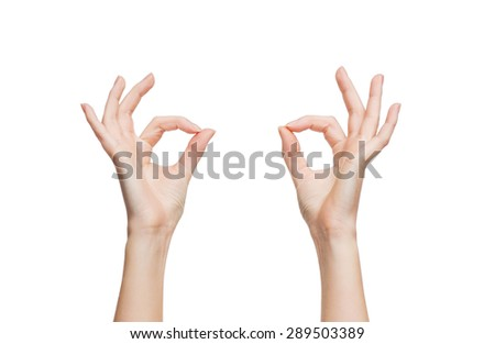gesture and body parts concept - woman hands showing ok sign
