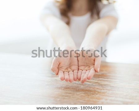 gesture, body parts and child concept - close up of little girl showing empty cupped hands - stock photo