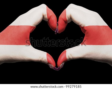 Gesture made by england flag colored hands showing symbol of heart and love