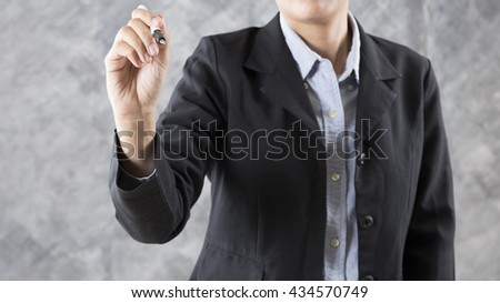 gesture of businesswoman hand holding pen writing  something for use as business concept - stock photo