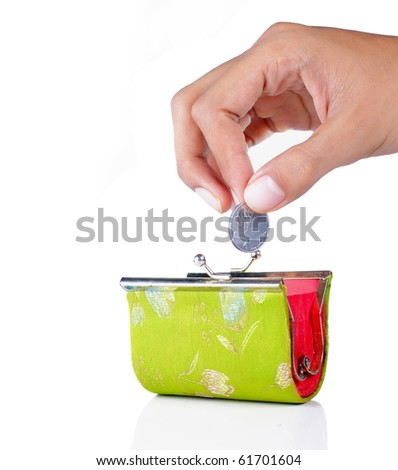 gesture of hand drop money into the wallet - stock photo
