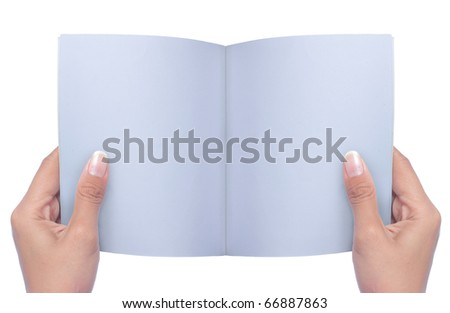 gesture of hand holding and reading a book over white background - stock photo