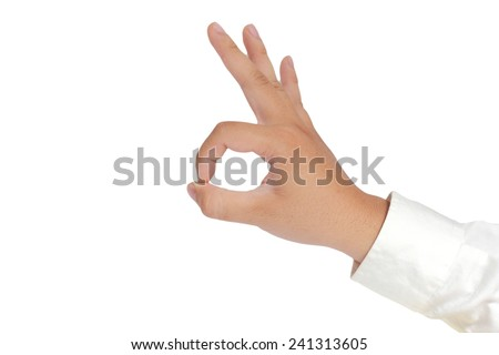 Gesture of hand showing OK sign with fingers in formal long sleeved shirt isolated on white - stock photo
