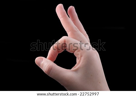 "gesture ""OK"" on the black background"