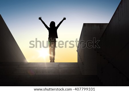 gesture, success, achievement and people concept - happy young woman or teenage girl silhouette showing thumbs up with both hands standing on stairs over sun light background - stock photo