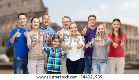 gesture, travel, tourism and people concept - happy family showing thumbs up over coliseum background