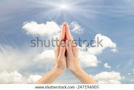 Gesture two praying hands together facing the sky - stock photo