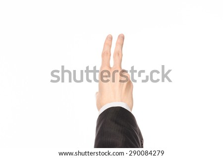 Gestures and Business theme: businessman shows hand gestures with a first-person in a black suit on a white background isolated - stock photo