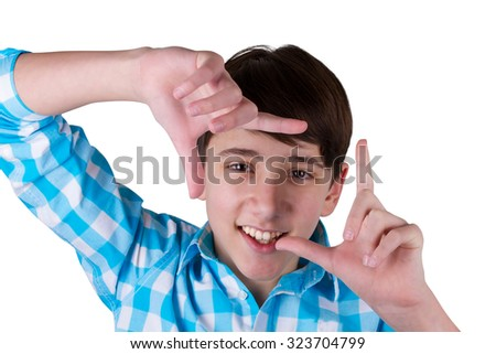 Gesturing finger frame. Handsome teenager looking at camera and gesturing finger frame while standing isolated on white - stock photo