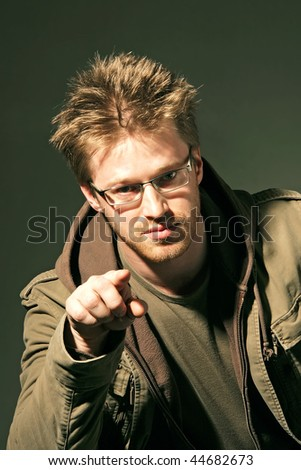 gesturing man showing with a index finger - stock photo