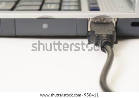 get connected - USB device plugged into a laptop - stock photo