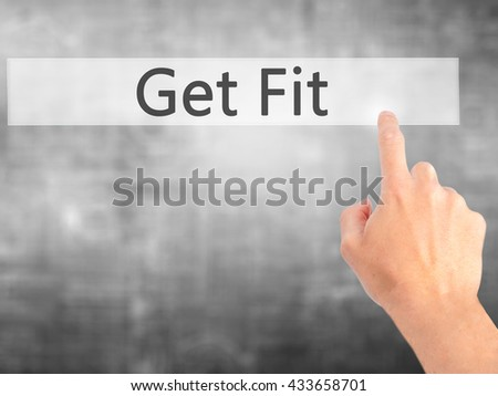 Get Fit - Hand pressing a button on blurred background concept . Business, technology, internet concept. Stock Photo