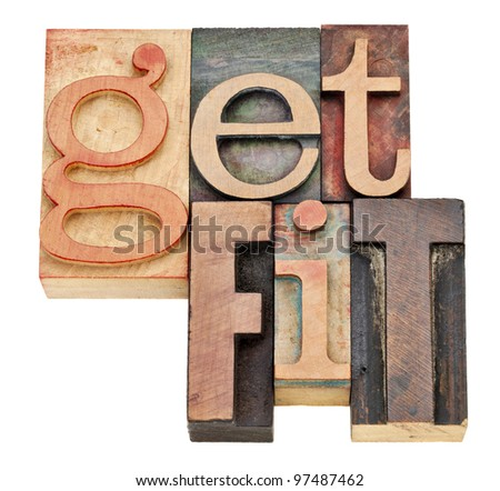 get fit - motivation concept  - isolated words in vintage letterpress wood type - stock photo