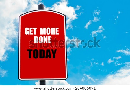 Get More Done Today motivational quote written on red road sign isolated over clear blue sky background. Concept  image with available copy space - stock photo