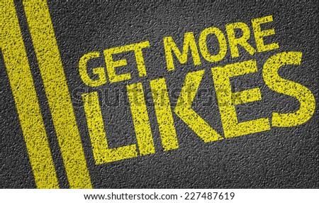 Get More Likes written on the road - stock photo