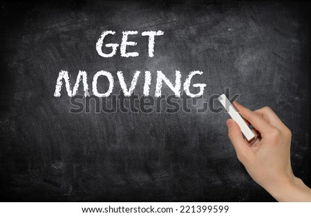 Get moving, written with white chalk - stock photo